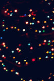 Christmas, New Year background with beautiful stars bokeh of colorful garland lights.  Royalty Free Stock Photo