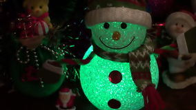 Christmas New Year Background 3. This is a beautiful New Year 2016 and Christmas Background video of lighting blurring Snowman and holiday lights, flares… stock video