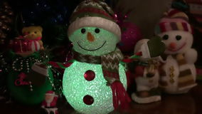 Christmas New Year Background 4. This is a beautiful New Year 2016 and Christmas Background video of lighting blurring Snowman and holiday lights, flares… stock video