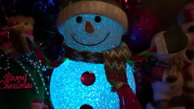 Christmas New Year Background 8. This is a beautiful New Year 2016 and Christmas Background video of lighting blurring Snowman and holiday lights, flares… stock footage