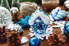 Christmas and New year background with blue toy house. Royalty Free Stock Photo