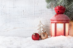 Christmas and New Year background. With Christmas candle lantern and Christmas decorations royalty free stock photography