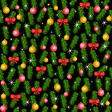 Christmas and New Year background. Colorful Christmas and  New Year background with pine branches and decoration. Seamless pattern Stock Photo