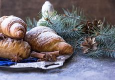 Christmas and New Year 2017 background with continental breakfast - with cinnamon orange and croissant. Decorations - snowflake cr Royalty Free Stock Image