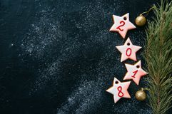 Christmas or new year background. Different shapes of gingerbrea. D cookies and decorations on a wooden backdrop. Copy space and top view stock images