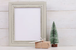 Christmas and New Year background. Empty picture frame, fir and vintage gift box with with copy space blank tag on white backgroun Stock Photography