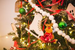 Christmas and New Year background with Eve Tree decorations. Wooden handmade skates as toy for holiday fur.  Stock Photo
