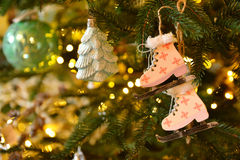 Christmas and New Year background with Eve Tree decorations. Wooden handmade skates as toy for holiday fur . Stock Photo