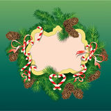 Christmas and New Year background - fir tree branc. Hes, pine cones and xmas sweets - oval frame Stock Photo