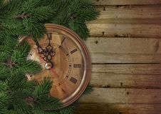 Christmas or New Year background with fir tree and vintage clock. Christmas vintage background with place for photo and text. Greeting card stock images