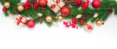 Christmas or New Year background. Gifts, colored glass balls, decoration and cones on white background