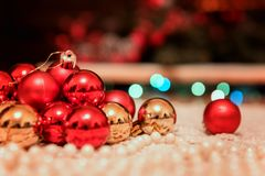 Christmas and New Year background with holiday decoration, lights and festive bokeh. Christmas and New Year background with holiday decoration - red and golden royalty free stock photography