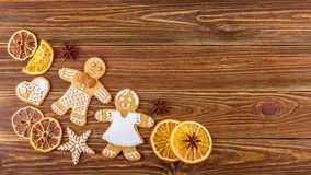 The Christmas or New Year background - Homemade christmas gingerbreads. On wooden boards Royalty Free Stock Images