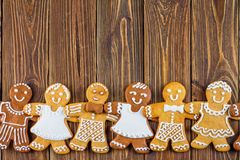 The Christmas or New Year background - Homemade christmas gingerbreads. On wooden boards Royalty Free Stock Photography