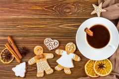 The Christmas or New Year background - Homemade christmas gingerbreads with a cup of coffee Stock Photos