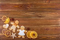 The Christmas or New Year background - Homemade christmas gingerbreads. On wooden boards Royalty Free Stock Photos