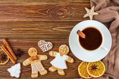 The Christmas or New Year background - Homemade christmas gingerbreads with a cup of coffee Stock Images