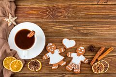 The Christmas or New Year background - Homemade christmas gingerbreads with a cup of coffee Stock Image