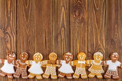The Christmas or New Year background - Homemade christmas gingerbreads. On wooden boards Stock Photography