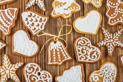 The Christmas or New Year background - Homemade christmas gingerbreads. On wooden boards Royalty Free Stock Image