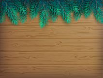 Christmas or New Year background with realistic fir branches on a wooden brown table. Vector illustration. Top view Royalty Free Stock Image