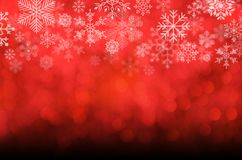 Christmas and New year background. Red blurred abstract backgrou. Christmas and New year theme background. Red blurred abstract background with snowflake Stock Images