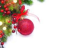 Christmas and New Year background. Red decorations and Christmas tree over white Royalty Free Stock Photography
