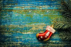 Christmas new year background. Red toy sock Santa Claus on the w Royalty Free Stock Image