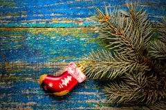 Christmas new year background. Red toy sock Santa Claus on the w Stock Image