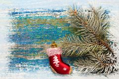 Christmas new year background. Red toy sock Santa Claus on woode Stock Images