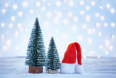 Christmas and New year background with Santa Claus hatand christmas trees. Holiday greeting card.  royalty free stock photography