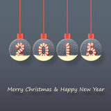 Christmas and new year background. Year 2015 sign in red and white Christmas sweet style in snow globe hanging on dark background Stock Photography