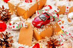Christmas and New year background with toy car present and tag Royalty Free Stock Images