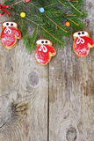 Christmas and New Year Background with Tree and Gingerbread Stock Images