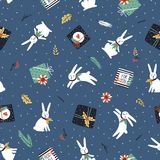 Christmas and New Year background. Vector seamless pattern with christmas tree, gift boxes, white rabbits and poinsettia. Christmas and New Year background Stock Image