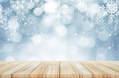 Christmas and New year background. Wooden table with winter snow. Christmas and New year theme background. Wooden table with winter snowfall background. Can be Royalty Free Stock Photography