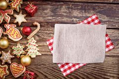 Christmas, New Year Background. Xmas wooden table with cookies and tablecloth, napkin. Top view, copy space, mockup.  stock photos
