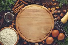 Christmas or New Year bakery background with ingredients for recipe of xmas pastry. Flat lay with blank space Royalty Free Stock Images