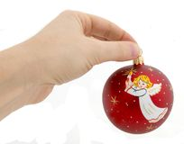 Christmas and New Year ball. New Year red ball in hand Stock Photography