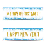 Christmas and New Year 2017 banner golden text and snowflakes. Merry Christmas and Happy New Year 2017 banner. Blue background with bokeh, snow, fog and Stock Photography