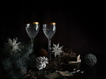 Christmas, new year. basket with fir branches and vintage champagne glasses. Stock Image
