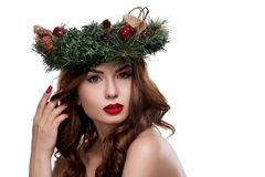 Christmas or New Year beauty girl portrait isolated on white background. Beautiful woman with luxury makeup and christmas wreath o. N head. Christmas mood Royalty Free Stock Photo