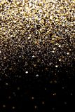 Christmas New Year Black And Gold Glitter Background. Holiday Abstract Texture Fabric Royalty Free Stock Photos