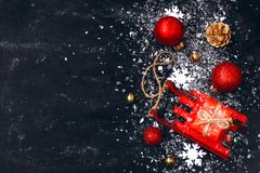 Christmas new year black background, red toy sled, balls, gift b Royalty Free Stock Image