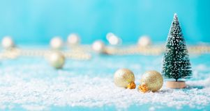 Christmas, New Year blue background with snow and green eve ornaments. Copy space. Christmas, New Year blue background with snow and green eve ornaments. Copy stock photography