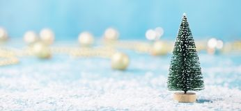 Christmas, New Year blue background with snow and green eve ornaments. Copy space. Christmas, New Year blue background with snow and green eve ornaments. Copy royalty free stock photo