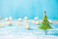 Christmas, New Year blue background with snow and green eve ornaments. Copy space. Christmas, New Year blue background with snow and green eve ornaments. Copy stock images