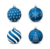 Christmas, New Year - Blue baubles with motives Stock Images