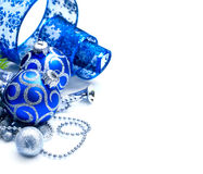 Christmas and New Year blue decoration isolated on white. Border art design with holiday baubles Stock Photos