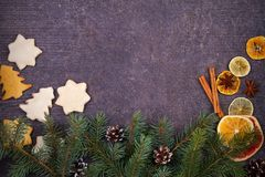 Christmas and New Year border or frame on grunge wooden background. Winter holidays concept. View from above, top studio shot Stock Photos